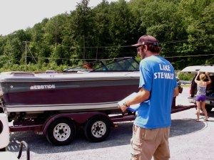 Michael Abrahamson, LGA lake steward, inspects boat at Dunham's Bay in 2011