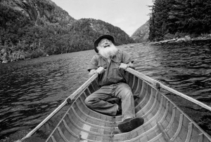 Brett Lawrence rowing a guideboat on Lower Ausable Lake, photo by Rebecca Soderholm