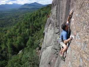 Jim Lawyer finesses his way up Hold It Like a Hamburger (5.11d) on Potter Mountain. Photo by Colin O'Connor