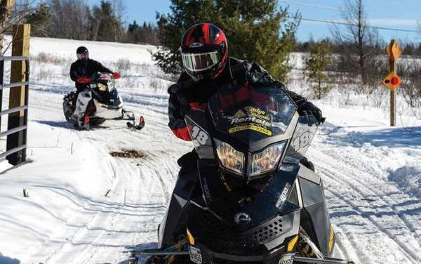 Governor Cuomo rides a snowmobile during the Adirondack Winter Challenge. Courtesy of New York State