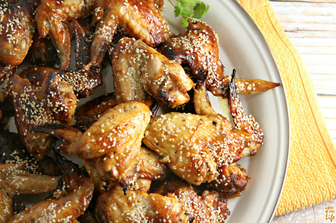 These Tangy Sesame Chicken Wings, with their Asian flair, are my go-to game day and party appetizer recipe! Everyone always raves about them, and they disappear quickly! YOU HAVE TO TRY THESE!