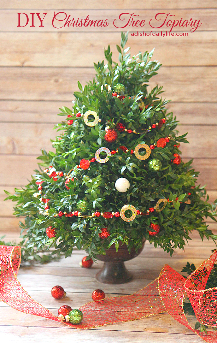 This festive DIY Christmas Tree Topiary is perfect for a hostess gift or for holiday decorating!