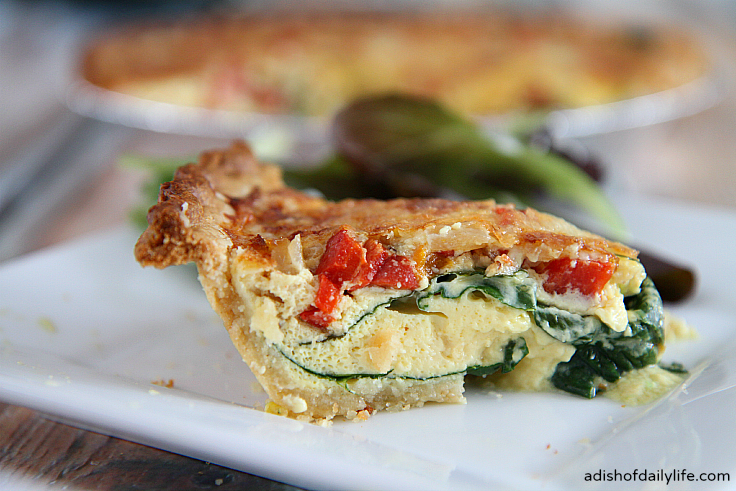 This spinach and roasted pepper quiche with Havarti cheese is a delicious holiday breakfast idea!