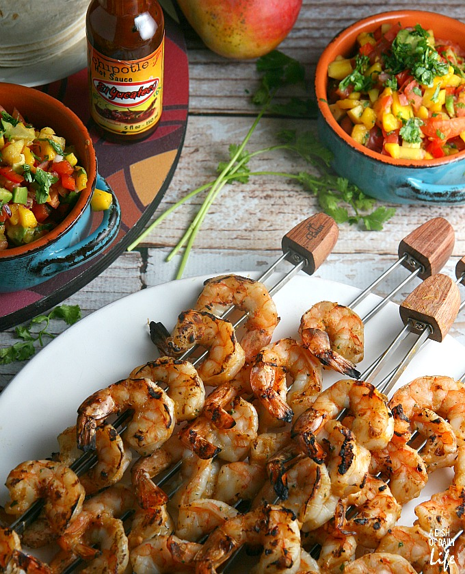 Mango Chipotle Shrimp...sweet mango paired with smoky chipotle makes for a barbeque sauce sensation! Perfect for dinner on the patio or a summer party, this grilling recipe takes just over 30 minutes from start to finish.