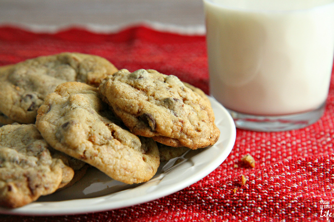 These chocolate chip coffee toffee cookies may look like an ordinary chocolate chip cookie, but bite into one and you are in for a delicious surprise! The toffee bits and a hint of coffee take the flavor of these chocolate chip cookies to a new level. You're definitely going to want to add them to your holiday baking list!
