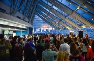Guests mingle in the Adler's Skyline Solarium at Adler After Dark, a monthly 21+ after-hours event!