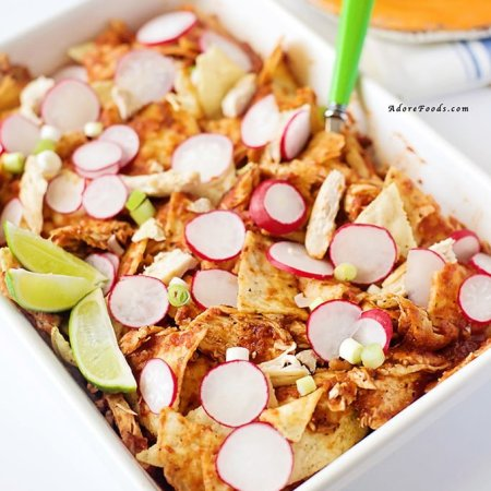 Chicken Chilaquiles - traditional Mexican style casserole is a mixture of tortilla chips, rich homemade red chile sauce and shredded chicken #mexican #cincodemayo