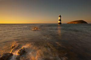 Penmon Lighthouse Sunset Gold