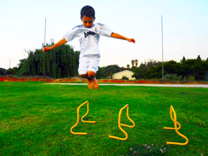 athlete-jumping-over-speed-hurdles