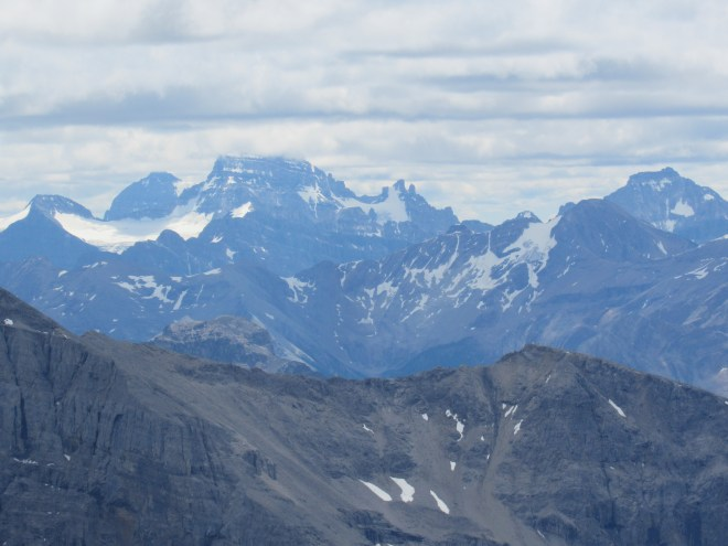 The top of Mt. Assiniboine (L of Center) remained stuck in the clouds. Photo looks S.