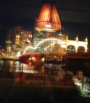 night-time view through a window at Grand Concourse restaurant