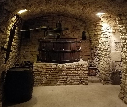 a view of an old grape press in the Drappier Cellars. Champagne Houses