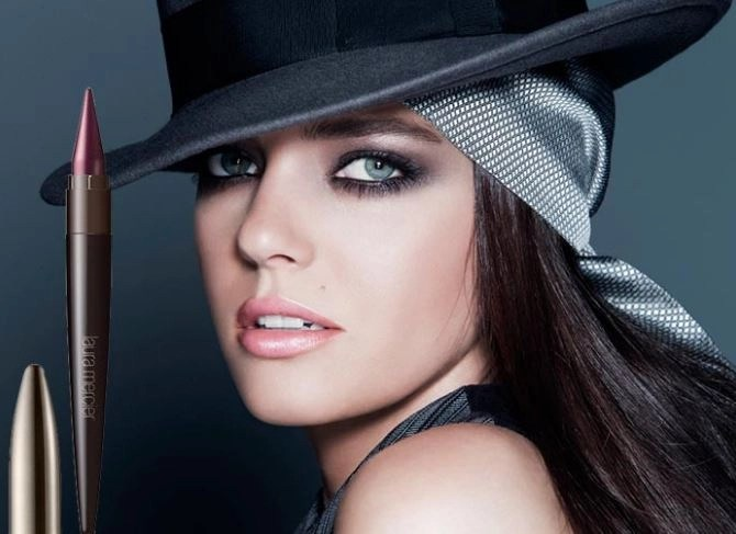 model wearing some of the products from the eyeconics colklection laura mercier
