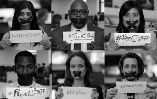 Six separate photos of journalists with black tape covering their mouths, each holding a sign that reads #FreeAJStaff