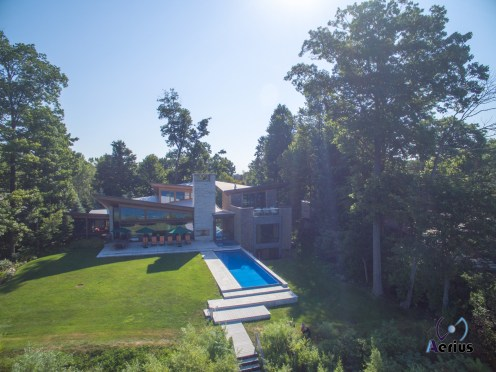 Modern Michigan Beach house with pool captured by a drone