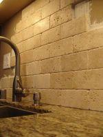 Santa Cecilia Granite With Travertine Tile Backsplash