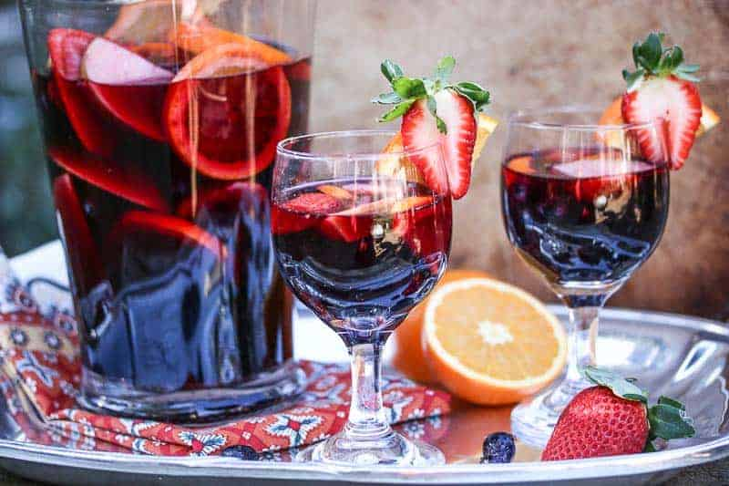 This Spanish inspired Pomegranate Red Wine Sangria is light, fruity, refreshing, and not overly sweet.