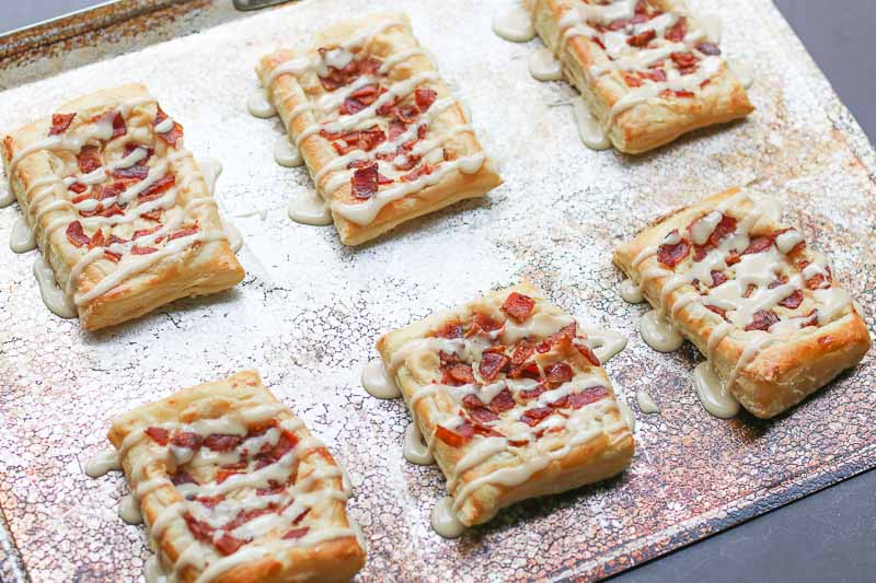 This Maple Glazed Bacon and Cream Cheese Danish Recipe is a sweet and salty twist on the traditional danish recipes. The salty, crunchy bacon balances the sweet maple glaze and cream cheese filling and tops a golden, flaky Pepperidge Farm® Puff Pastry. It is AMAZING and you are going to LOVE it!