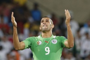 Algeria's Islam Slimani reacts after missing a goal during their African Nations Cup (AFCON 2013) Group D soccer match against Tunisia in Rustenburg