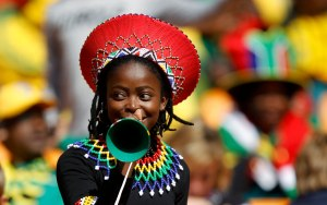 A soccer fan blows a vuvuzela while awaiting the start of the opening ceremony of the 2010 World Cup at Soccer City stadium in Johannesburg