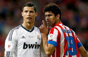 Real Madrid's Cristiano Ronaldo (L) listens to Atletico de Madrid's Diego Costa during their Spanish King's Cup final soccer match at Santiago Bernabeu stadium in Madrid May 17, 2013.   REUTERS/Juan Medina (SPAIN - Tags: SPORT SOCCER) - RTXZR28