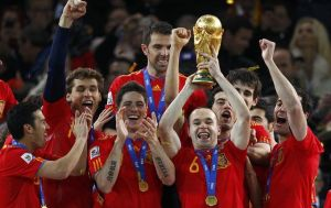 Spain's Iniesta holds the World Cup trophy after the 2010 World Cup final soccer match between Netherlands and Spain at Soccer City stadium in Johannesburg