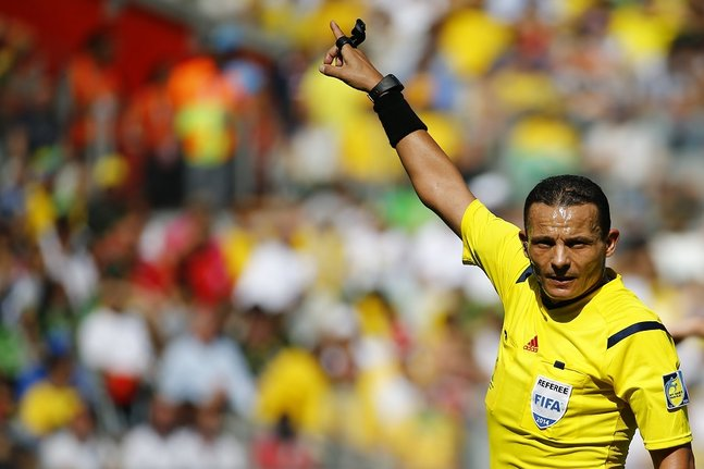 Referee Haimoudi of Algeria gestures during the 2014 World Cup Group D soccer match between England and Costa Rica at the Mineirao stadium in Belo Horizonte