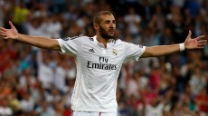 Real Madrid's Benzema celebrates after scoring a goal against Basel during their Champions League soccer match in Madrid