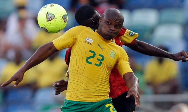 South Africa's Tokelo Rantie, foreground, is challenged by Angola's Dany Massunguna in their African Cup of Nations Group A soccer match at Moses Mabhida Stadium in Durban, South Africa, Wednesday, Jan. 23, 2013. (AP Photo/Rebecca Blackwell)