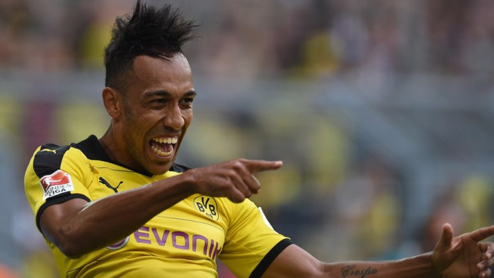 Dortmund's Gabonese striker Pierre-Emerick Aubameyang  celebrates scoring during the German first division Bundesliga football match Borussia Dortmund vs Borussia Moenchengladbach in Dortmund, western Germany, on August 15, 2015.  AFP PHOTO / PATRIK STOLLARZ..RESTRICTIONS: DURING MATCH TIME: DFL RULES TO LIMIT THE ONLINE USAGE TO 15 PICTURES PER MATCH AND FORBID IMAGE SEQUENCES TO SIMULATE VIDEO. .== RESTRICTED TO EDITORIAL USE ==.FOR FURTHER QUERIES PLEASE CONTACT DFL DIRECTLY AT + 49 69 650050.        (Photo credit should read PATRIK STOLLARZ/AFP/Getty Images)