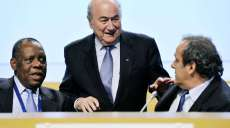 FILE - In this May 25, 2012 file photo FIFA President Joseph Blatter, center, chats with Confederation of African Football, CAF, President Issa Hayatou, left, and UEFA President Michel Platini during the second day session of the 62nd FIFA Congress in Budapest, Hungary. FIFA said Thursday, Oct. 8, 2015 that African soccer leader Isaa Hayatou will serve as acting president after Blatter and Platini have been banned for 90 days. (Laszlo Beliczay/MTI via AP, file)/FOS134/566431755391/May 25, 2012 file photo/1510081438