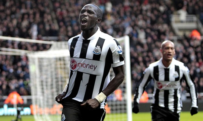 """Newcastle United's French midfielder, Moussa Sissoko celebrates scoring their second goal during the English Premier League football match between Chelsea and Newcastle United at St James Park, Newcastle upon Tyne, England, on February 2, 2013. AFP PHOTO/GRAHAM STUART - FOR EDITORIAL USE   RESTRICTED TO EDITORIAL USE. No use with unauthorized audio, video, data, fixture lists, club/league logos or """"live"""" services. Online in-match use limited to 45 images, no video emulation. No use in betting, games or single club/league/player publications.        (Photo credit should read GRAHAM STUART/AFP/Getty Images)"""