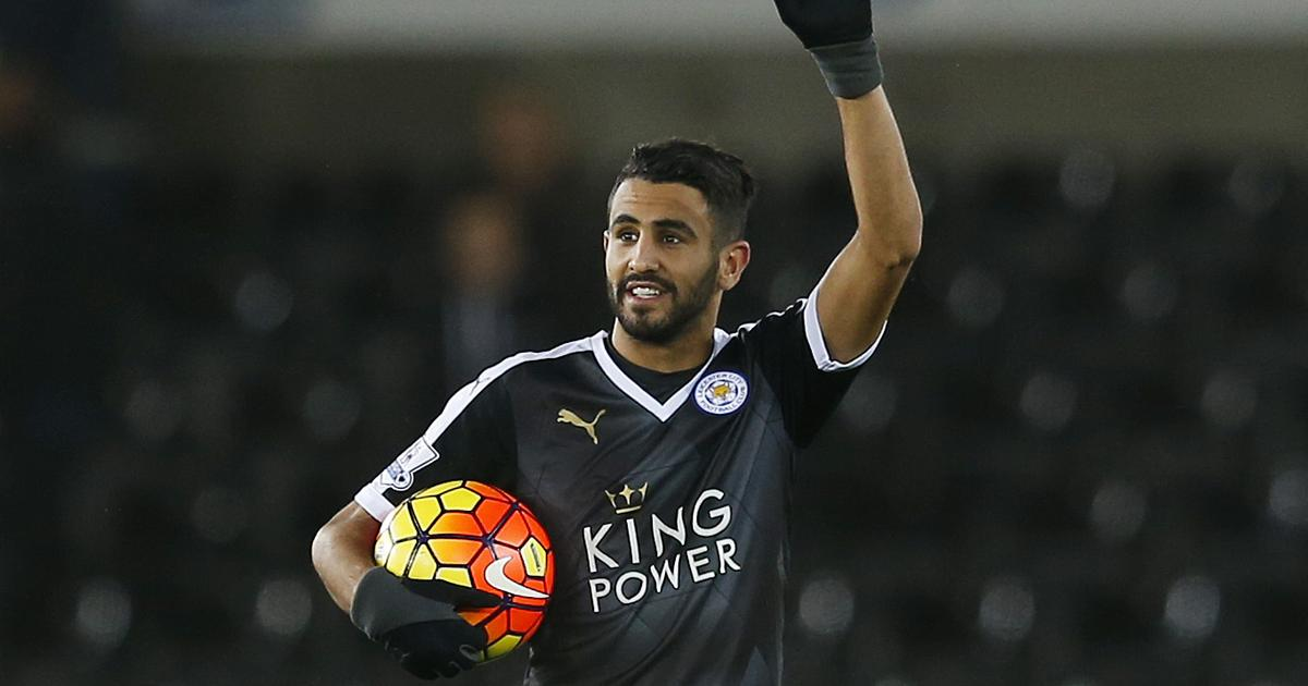 "Football Soccer - Swansea City v Leicester City - Barclays Premier League - Liberty Stadium - 5/12/15 Leicester City's Riyad Mahrez celebrates with the match ball after the game after scoring a hat trick Action Images via Reuters / Paul Childs Livepic EDITORIAL USE ONLY. No use with unauthorized audio, video, data, fixture lists, club/league logos or ""live"" services. Online in-match use limited to 45 images, no video emulation. No use in betting, games or single club/league/player publications.  Please contact your account representative for further details. - RTX1XC0L"
