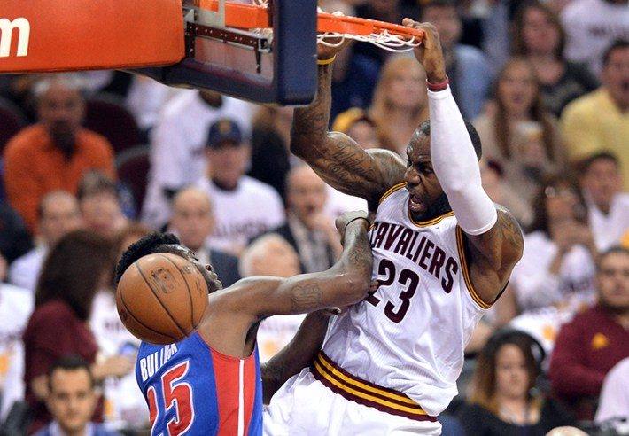Apr 20, 2016; Cleveland, OH, USA; Cleveland Cavaliers forward LeBron James (23) slam dunks over Detroit Pistons forward Reggie Bullock (25) during the second quarter in game two of the first round of the NBA Playoffs at Quicken Loans Arena. Mandatory Credit: Ken Blaze-USA TODAY Sports