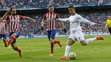 Real Madrid's Cristiano Ronaldo, right, prepares to cross the ball during a Spanish La Liga soccer match between Real Madrid and Atletico Madrid at the Santiago Bernabeu stadium in Madrid, Spain, Saturday Feb. 27, 2016. (AP Photo/Paul White)/PW119/969310651830/1602271817