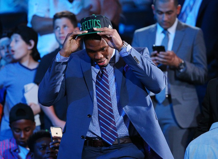 Jun 23, 2016; New York, NY, USA; Guerschon Yabusele puts on a team cap after being selected as the number sixteen overall pick to the Boston Celtics in the first round of the 2016 NBA Draft at Barclays Center. Mandatory Credit: Brad Penner-USA TODAY Sports