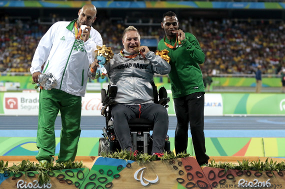 RIO DE JANEIRO, BRAZIL - SEPTEMBER 10: (L-R) Silver medalist Kamel Kardjena of Algeria , Gold medalist Daniel Scheil of Germany and Bronze medalist Hani Alnakhli of Saudi Arabia celebrate on the podium at the medal ceremony for the Menâs Shot Put â F33 Final during day 3 of the Rio 2016 Paralympic Games at the Olympic Stadium on September 9, 2016 in Rio de Janeiro, Brazil. (Photo by Alexandre Loureiro/Getty Images)