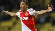 "Monaco's French forward Kylian Mbappe Lottin celebrates after scoring a goal during the French L1 football match Monaco (ASM) vs Troyes (ESTAC) on February 20, 2016 at the ""Louis II Stadium"" in Monaco.  AFP PHOTO / VALERY HACHE / AFP / VALERY HACHE        (Photo credit should read VALERY HACHE/AFP/Getty Images)"