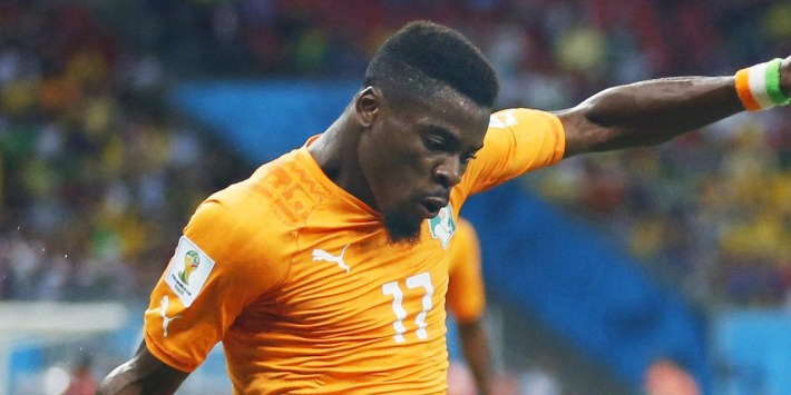 ©Kyodo/MAXPPP - 17/06/2014 ; RECIFE, Brazil - Japan's Shinji Kagawa (R) tries to block Ivory Coast's Serge Aurier during the first half of a World Cup Group C match at Arena Pernambuco in Recife, Brazil, on June 14, 2014. Ivory Coast won 2-1. (Kyodo) (MaxPPP TagID: maxsportsworldtwo165101.jpg) [Photo via MaxPPP]