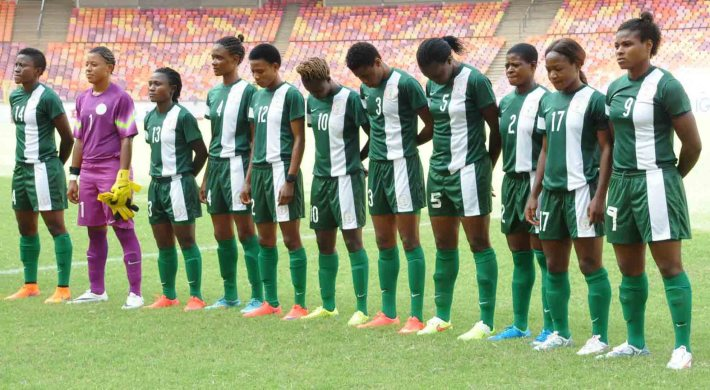 PIC. 6. SUPER FALCONS OBSERVE 'A MINUTE SILENCE' IN HONOUR OF THE TEAM'S MEDIA   OFFICER, LATE GRACIOUS AKUJOBI, BEFORE THE RIO 2016 OLYMPIC QUALIFIER BETWEEN   NIGERIA AND EQUATORIAL GUINEA IN ABUJA ON SATURDAY (18/7/15). 5432/18/7/2015/BJO/NAN