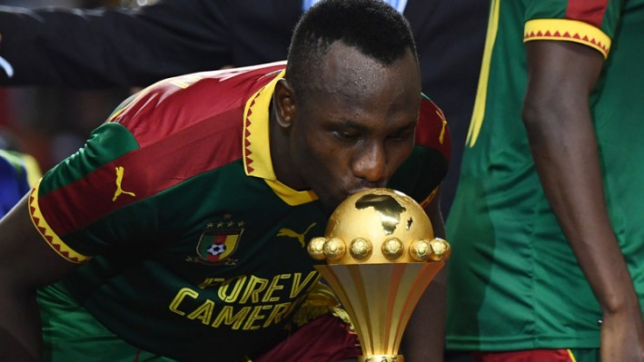Cameroon's forward Jacques Zoua kisses the winner's trophy after Cameroon beat Egypt 2-1 in the 2017 Africa Cup of Nations final football match between Egypt and Cameroon at the Stade de l'Amitie Sino-Gabonaise in Libreville on February 5, 2017. / AFP PHOTO / GABRIEL BOUYS