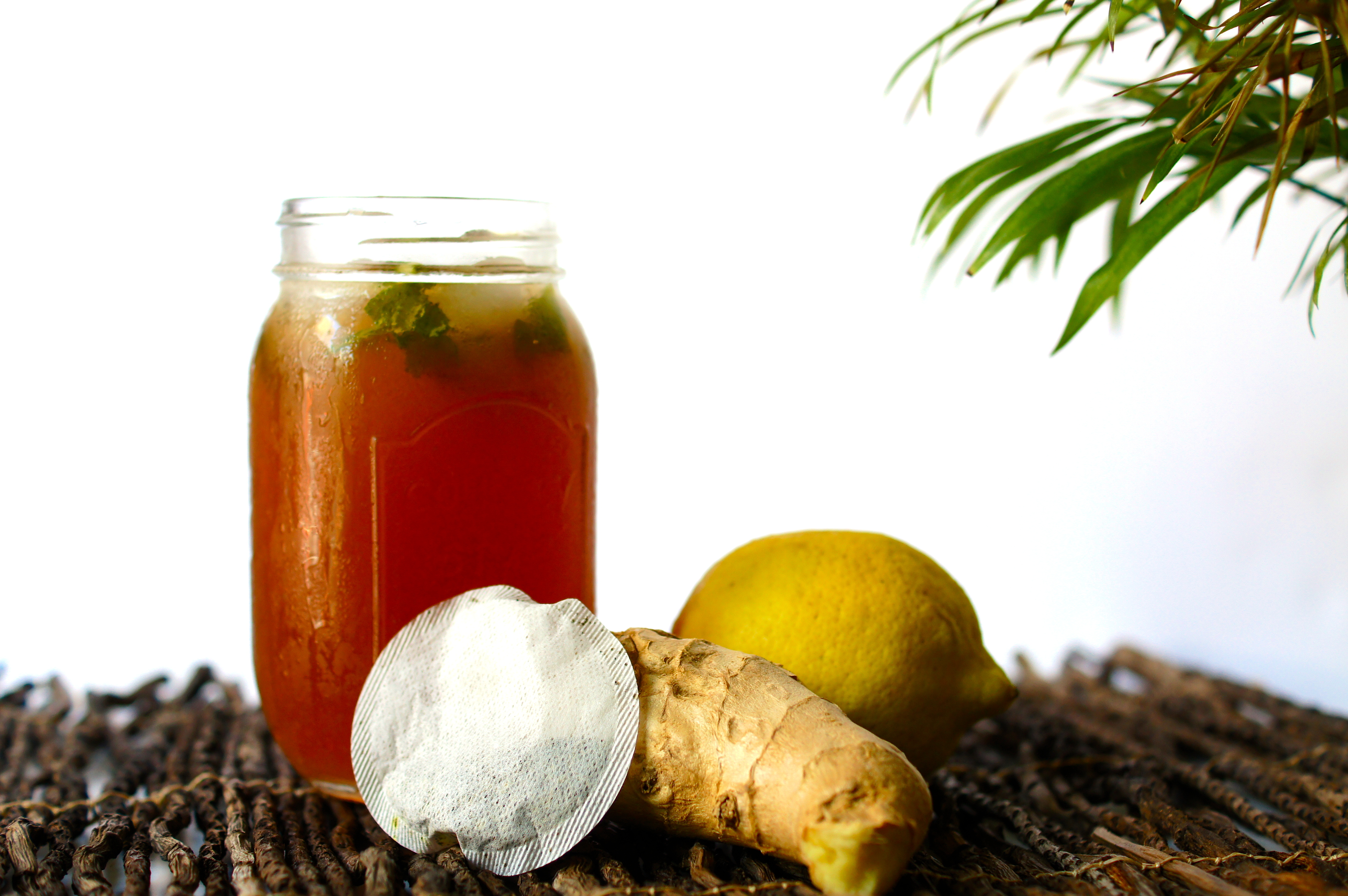 of ice, mix the tea, ginger juice, lemon juice and honey. Add the mint ...