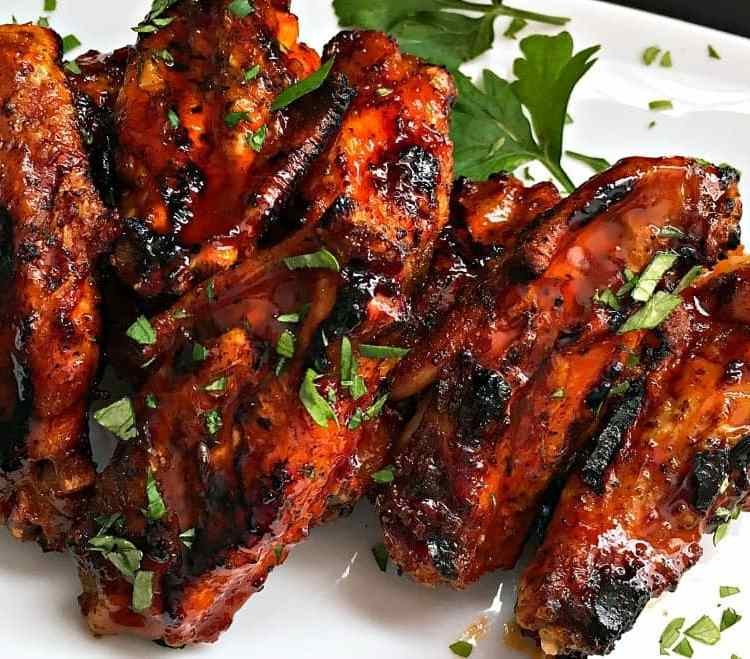 Easy Grilled Spicy Chicken Wings with a sweet-spicy Jack Daniels sauce. Don't let summer pass without making this one!