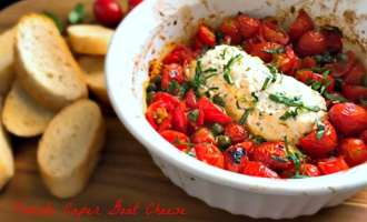 Tomato Caper Goat Cheese Appetizer ~ roasted tomatoes and capers surrounding a baked, warm mound of garlic herb goat cheese. Serve with toasted baguette.
