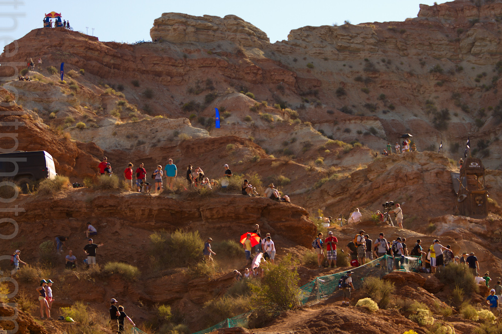 Spectators line the cliffs and desert at the Red Bull Rampage venue in Virgin, Utah.