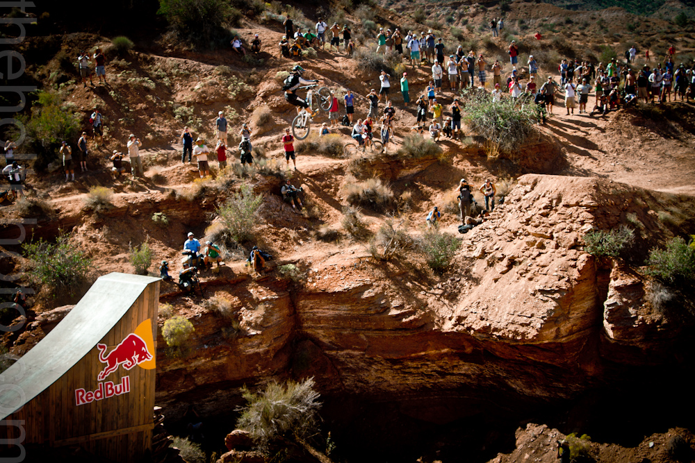 A mountain biker clears the massive canyon gap at Red Bull Rampage in Utah.