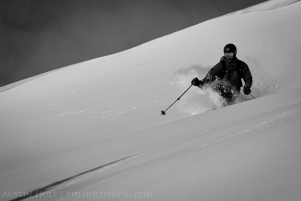 A backcountry telemark skier making a turn in powder snow in Utah.