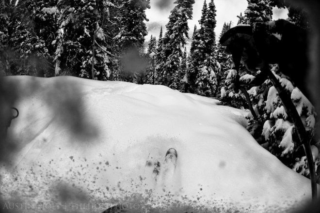 A POV angle of skis breaking through fresh powder at Solitude Mountain Resort