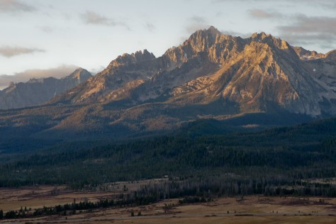 Warm, early morning light turns the dramatic sawtooth mountains yellow near Stanley, Idaho.