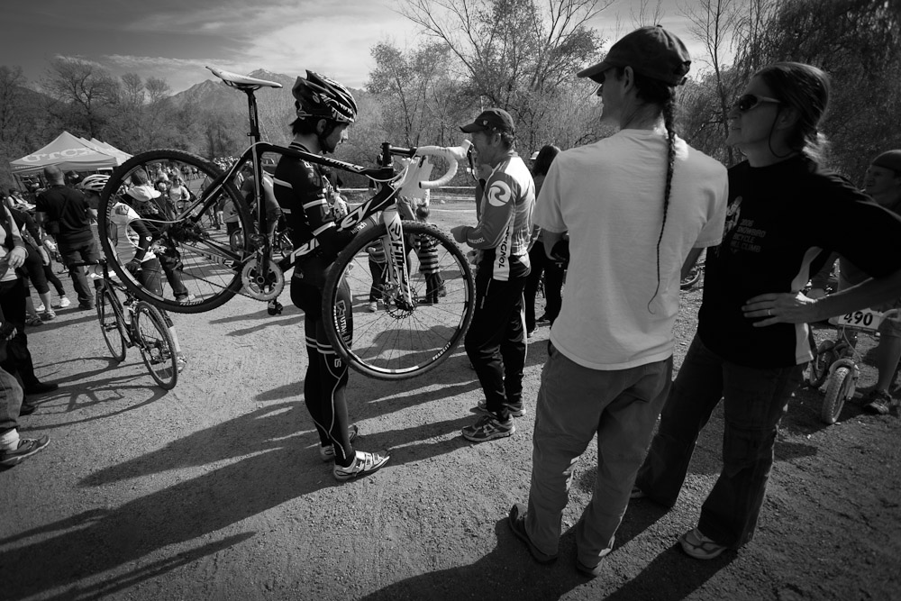A man with a bike and a man with a rat tail at the UTCX cyclocross bike race in Salt Lake City, Utah.